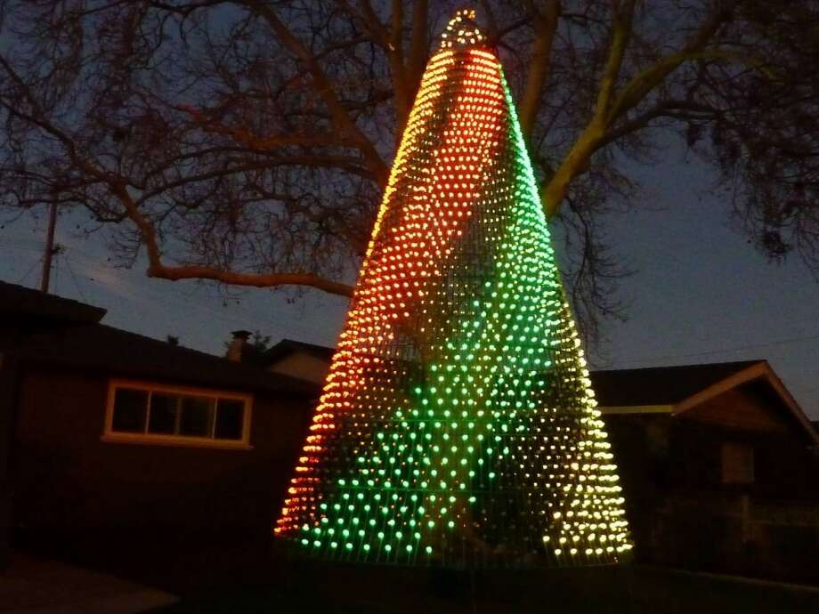 1683 Catalonia Way San Jose, Santa Clara County, 95125 - A 25 foot tall Christmas tree of lights, suspended from the limb of an 80-year old sycamore tree.  Each of the tree's 3200 lights can change into one of 4096 colors. The light show is choreographed to music and the music is transmitted to 92.9 FM. Photo: Lightsofthevalley.com