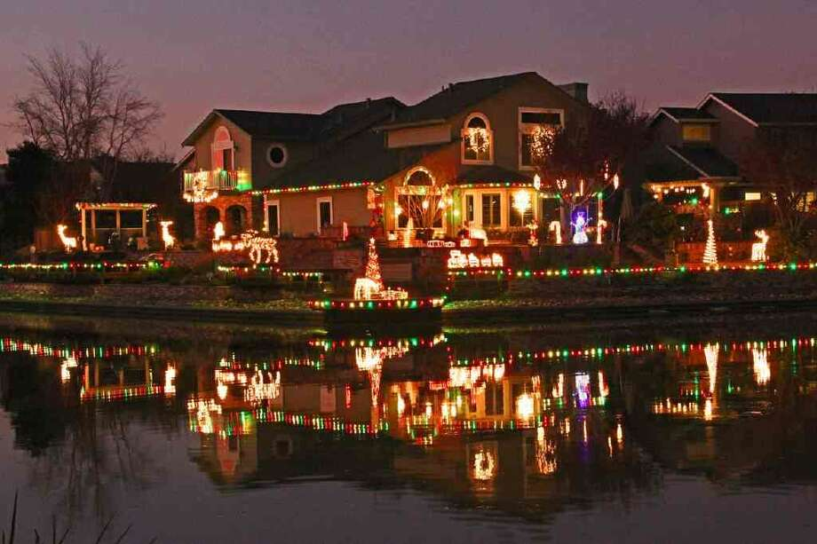 "78 Kilkenny Place, Alameda, Alameda County, 94502 - This display is known as ""Reflections of Christmas"". The Lighting display is best viewed from the rear of the house where it is reflected in a lagoon. Drive or walk across the lagoon on Auginbaugh Way near cross street Mecartney Road. Photo: Lightsofthevalley.com"