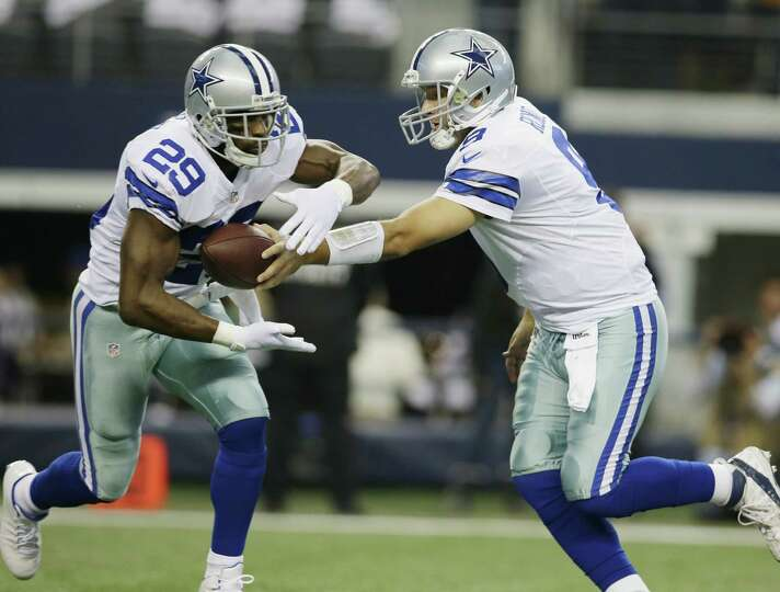 Dallas QB Tony Romo (right) handed off the ball to running back DeMarco Murray only seven times i