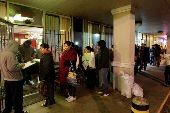 People queue up to see Cau Chin, a Buddhist monk and spiritual adviser, at his storefront in a shopping center off Boone Road. He sees 60 to 80 people a day.