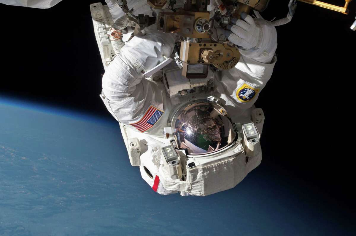 Astronaut Chris Cassidy walks in space last May to inspect and replace a pump controller box after a coolant leak. Now space station crew members must work in space again on the coolant system.
