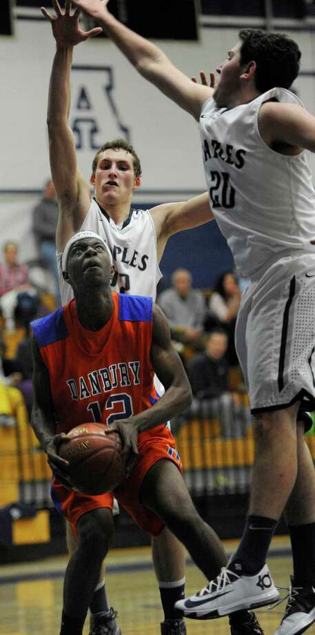 Danbury high school's Josh Nelson about to go up for a shot during a boys basketball game against Staples high school played at Staples, Westport, CT on Wednesday, December,18th, 2013. Photo: Mark Conrad / Connecticut Post Freelance