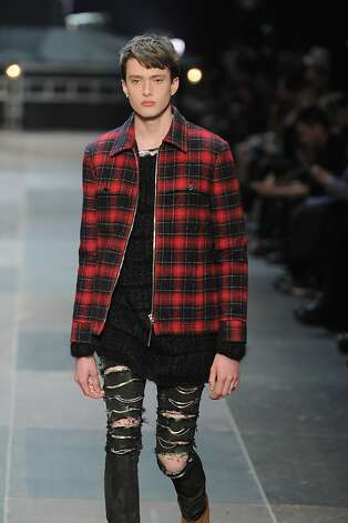 Men's trends: Spring 2013 for men was defined by the chambray. The classic shirt made a huge comeback worn with jeans, suits and shorts.  But it was grown-up grunge defined fall with dark (cuffed) denim, plaid, luxe motorcycle jackets and statement boots. Camouflage made a comeback that promises to stick around into 2014. Read more » Photo: Chris Moore/Catwalking, Getty Images