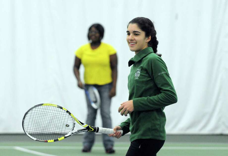 Shannon Mukerji, a senior and tennis player at Shaker High, teaches tennis to teens from Safe, an organization that takes at-risk kids off the streets of Schenectady, at Tri-City Tennis on Saturday Dec. 14, 2013 in Latham , N.Y. (Michael P. Farrell/Times Union) Photo: Michael P. Farrell / 00025006A