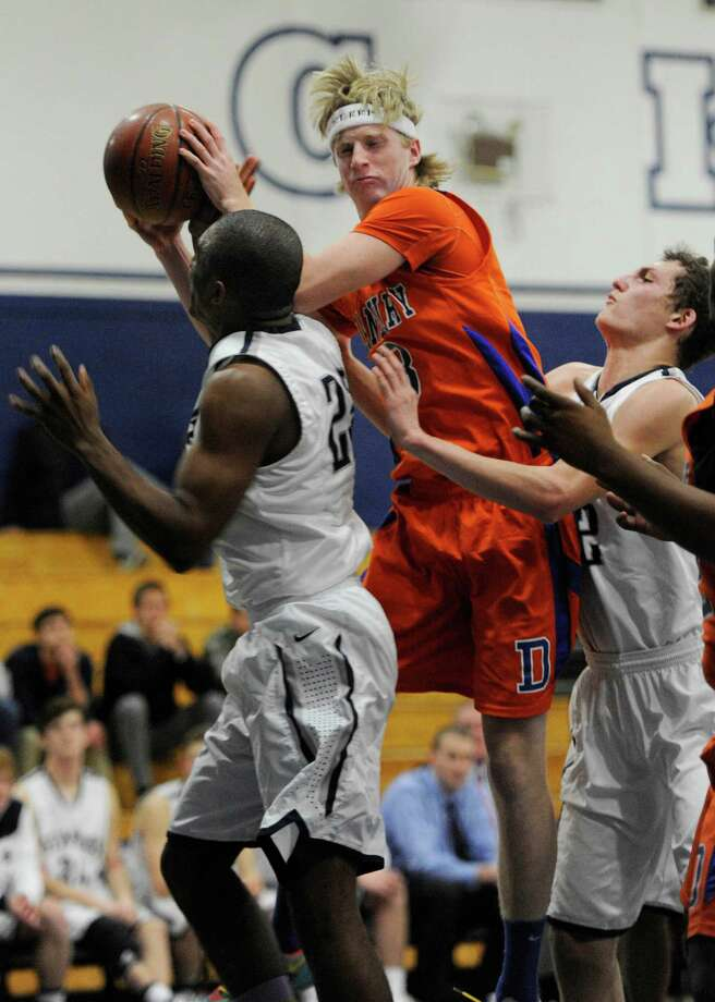 Danbury high school's Corey Brosz pulls down a rebound during a boys basketball game against Staples high school played at Staples, Westport, CT on Wednesday, December,18th, 2013. Photo: Mark Conrad / Connecticut Post Freelance