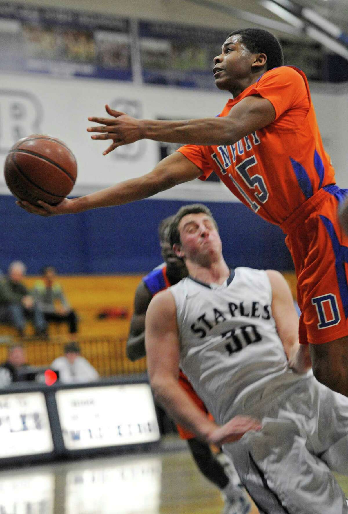 Danbury high school's Tysheen McCrea driving to the basket during a boys basketball game against Staples high school played at Staples, Westport, CT on Wednesday, December,18th, 2013.
