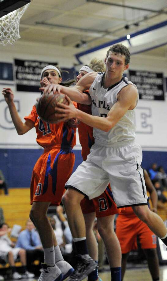 Staples high school's Nick Esposito battles for a rebound during a boys basketball game against Danbury high school played at Staples, Westport, CT on Wednesday, December,18th, 2013. Photo: Mark Conrad / Connecticut Post Freelance