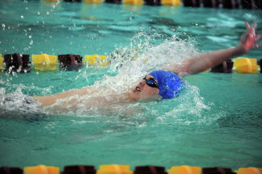 Fairfield Ludlowe's John Whiteside competes in the 100 meter backstroke event during a meet with Fairfield Warde and Wilton Wednesday Dec. 18, 2013 at the YMCA in Wilton, Conn. Photo: Autumn Driscoll / Connecticut Post