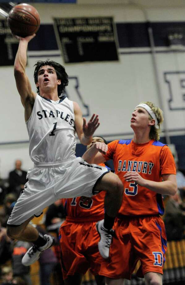 Staples high school's Jake Melnick goes up for a shot during a boys basketball game against Danbury high school played at Staples, Westport, CT on Wednesday, December,18th, 2013. Photo: Mark Conrad / Connecticut Post Freelance