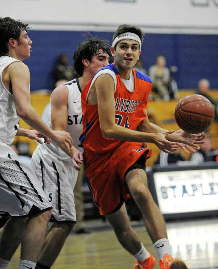 Danbury high school against Staples high school in a boys basketball game played at Staples, Westport, CT on Wednesday, December,18th, 2013. Photo: Mark Conrad / Connecticut Post Freelance