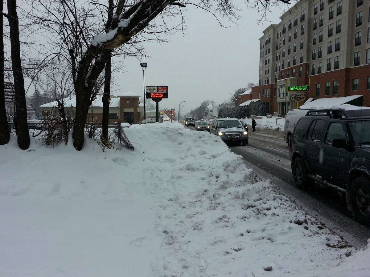 An impassable sidewalk along Hoosick Street in Troy. (Photo by Chris Churchill / Times Union)