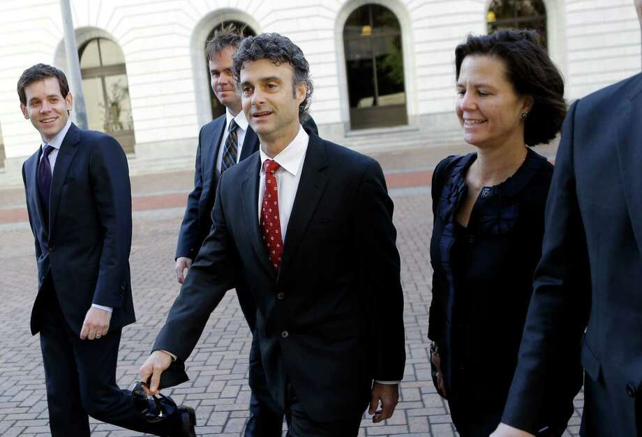 Kurt Mix, center, arrives with his legal team at Federal Court in New Orleans on Dec. 18, 2013, to hear the jury's guilty verdict on a charge he deleted text messages from his cell phone to obstruct a federal investigation of the company's massive 2010 oil spill in the Gulf of Mexico. Photo: Gerald Herbert, STF / AP