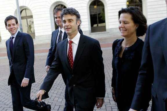 Kurt Mix, center, arrives with his legal team at Federal Court in New Orleans on Dec. 18, 2013, to hear the jury's guilty verdict on a charge he deleted text messages from his cell phone to obstruct a federal investigation of the company's massive 2010 oil spill in the Gulf of Mexico.