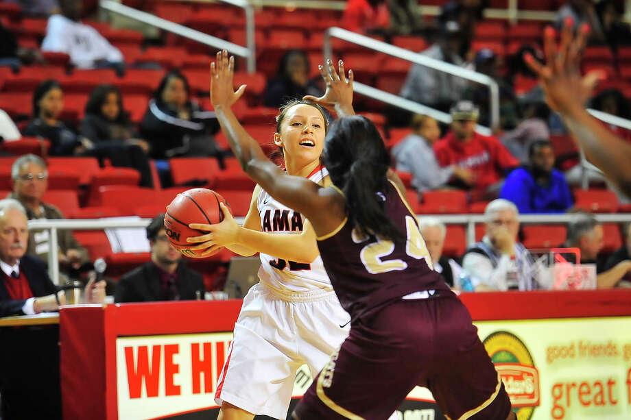The Lamar Lady Cardinals Shauna Long looks for an open teammate during the third period against the Texas State Lady Bobcats at the The Montagne Center Wednesday. The final score was Lamar 68, Texas State 55. Michael Rivera/@michaelrivera88