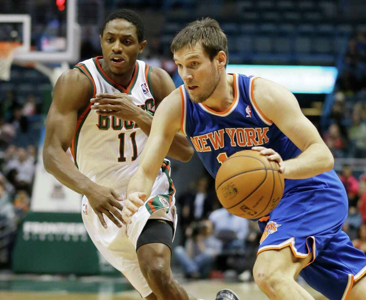 New York Knicks' Beno Udrih, right, drives past Milwaukee Bucks' Brandon Knight (11) during the first half of an NBA basketball game on Wednesday, Dec. 18, 2013, in Milwaukee. (AP Photo/Morry Gash) ORG XMIT: WIMG105