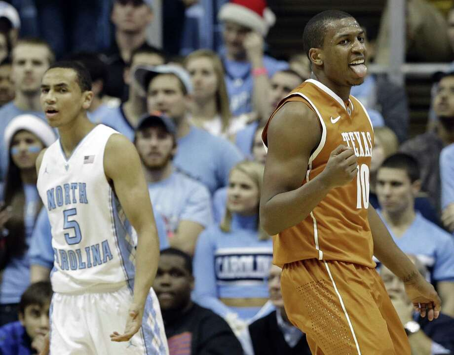 Antonian product Jonathan Holmes, who scored 15 points and grabbed 10 rebounds, reacts after a Texas basket in the first half. The Longhorns have won six of seven vs. the Tar Heels. Photo: Gerry Broome / Associated Press / AP