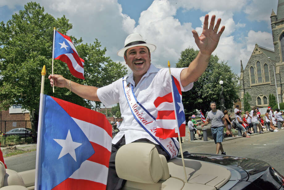 Bridgeport Police Officer Juan Santiago was the Grand Marshall in Bridgeport's annual Puerto Rican Day Parade in 2010. Santiago, a 28-year veteran of the police department, accidently shot himself with a handgun in a Bridgeport Bagel King restaurant on Dec. 17, 2013. Photo: B.K. Angeletti / Connecticut Post freelance