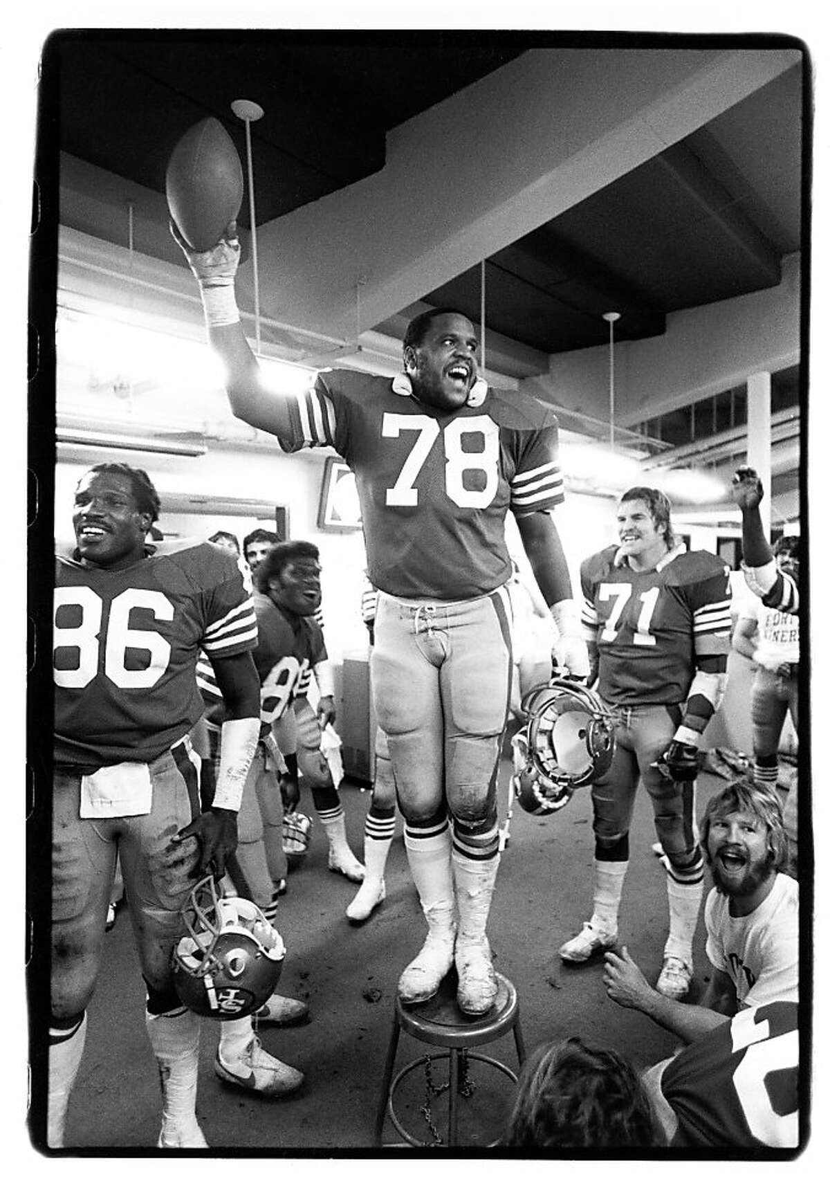 SAN FRANCISCO - DECEMBER 7: Defensive tackle Archie Reese #78 of the San Francisco 49ers holds the game ball in the locker room following the game against the New Orleans Saints at Candlestick Park on December 7, 1980 in San Francisco, California. The Niners came back from a 35-7 deficit to win 38-35 in the greatest regular season comeback in NFL history. (Photo by Michael Zagaris/Getty Images)
