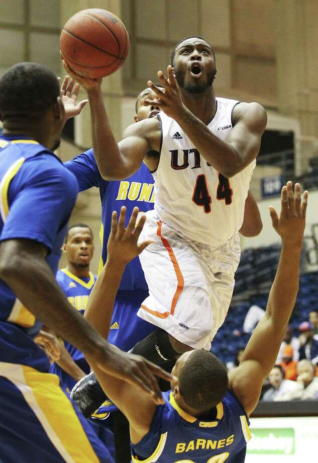 UTSA's Keon Lewis drives through Bakersfield's Brandon Barnes in Wednesday's blowout loss at the Convocation Center. Photo: Kin Man Hui / San Antonio Express-News / ©2013 San Antonio Express-News