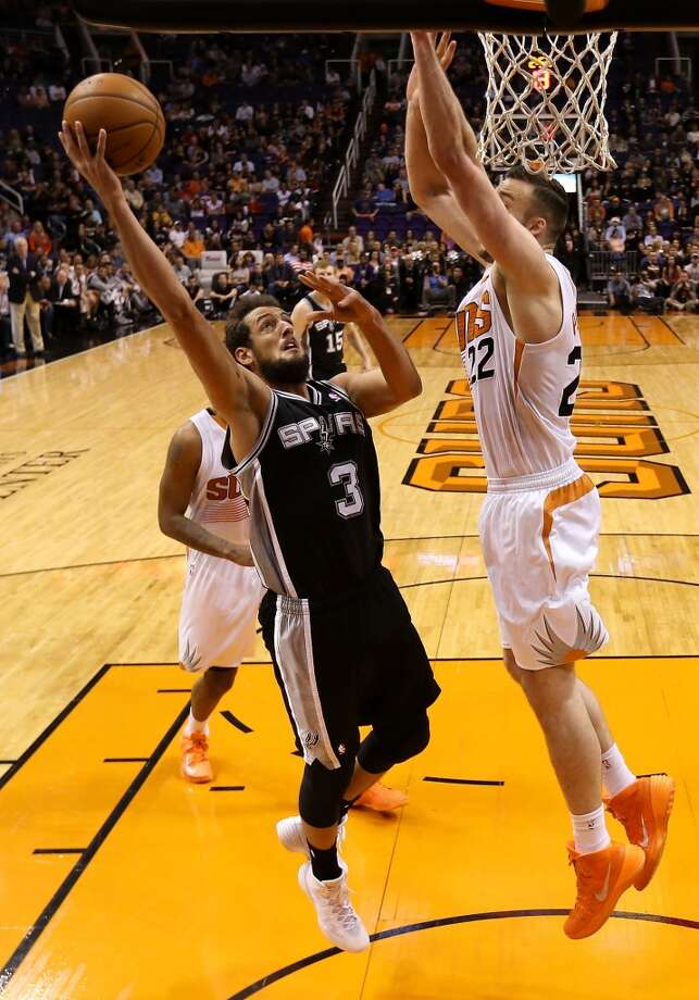 Marco Belinelli #3 of the San Antonio Spurs puts up a shot over Miles Plumlee #22 of the Phoenix Suns during the first half of the NBA game at US Airways Center on December 18, 2013 in Phoenix, Arizona.  NOTE TO USER: User expressly acknowledges and agrees that, by downloading and or using this photograph, User is consenting to the terms and conditions of the Getty Images License Agreement.  (Photo by Christian Petersen/Getty Images) Photo: Christian Petersen, Getty Images