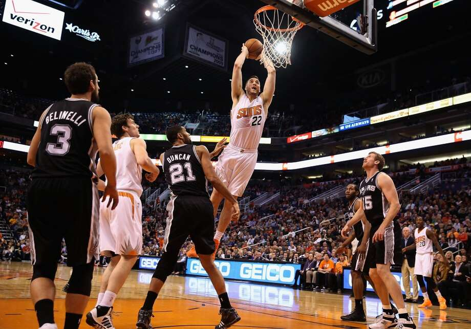 Miles Plumlee #22 of the Phoenix Suns slam dunks the ball against the San Antonio Spurs during the first half of the NBA game at US Airways Center on December 18, 2013 in Phoenix, Arizona.  NOTE TO USER: User expressly acknowledges and agrees that, by downloading and or using this photograph, User is consenting to the terms and conditions of the Getty Images License Agreement.  (Photo by Christian Petersen/Getty Images) Photo: Christian Petersen, Getty Images