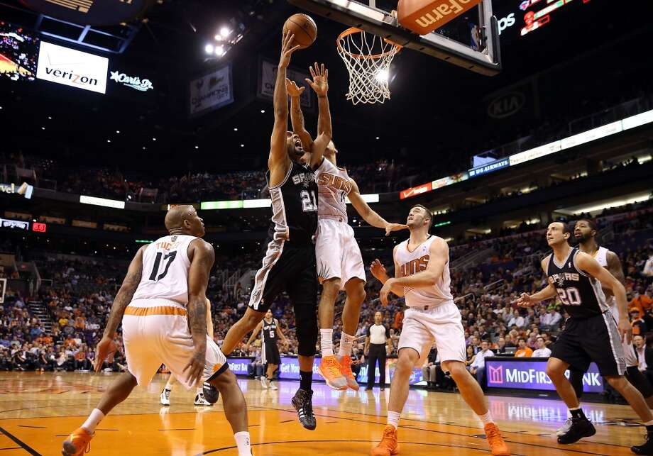 Tim Duncan #21 of the San Antonio Spurs puts up a shot over Gerald Green #14 of the Phoenix Suns during the second  half of the NBA game at US Airways Center on December 18, 2013 in Phoenix, Arizona.  The Spurs defeated the 108-101.  NOTE TO USER: User expressly acknowledges and agrees that, by downloading and or using this photograph, User is consenting to the terms and conditions of the Getty Images License Agreement.  (Photo by Christian Petersen/Getty Images) Photo: Christian Petersen, Getty Images