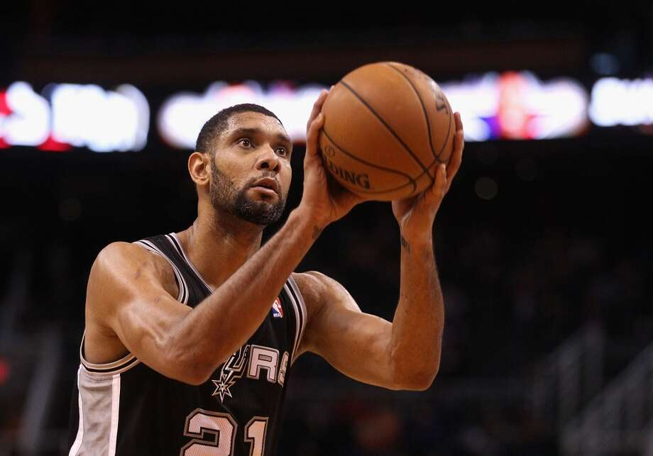 PHOENIX, AZ - DECEMBER 18:  Tim Duncan #21 of the San Antonio Spurs shoots a free throw shot against the Phoenix Suns during the NBA game at US Airways Center on December 18, 2013 in Phoenix, Arizona. The Spurs defeated the 108-101.  NOTE TO USER: User expressly acknowledges and agrees that, by downloading and or using this photograph, User is consenting to the terms and conditions of the Getty Images License Agreement.  (Photo by Christian Petersen/Getty Images) Photo: Christian Petersen, Getty Images