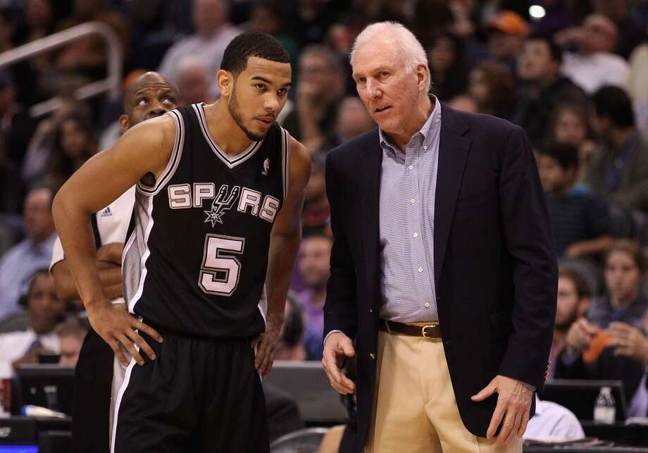PHOENIX, AZ - DECEMBER 18:  Head coach Gregg Popovich of the San Antonio Spurs talks with Cory Joseph #5 during the NBA game against the Phoenix Suns at US Airways Center on December 18, 2013 in Phoenix, Arizona. The Spurs defeated the 108-101.  NOTE TO USER: User expressly acknowledges and agrees that, by downloading and or using this photograph, User is consenting to the terms and conditions of the Getty Images License Agreement.  (Photo by Christian Petersen/Getty Images) Photo: Christian Petersen, Getty Images