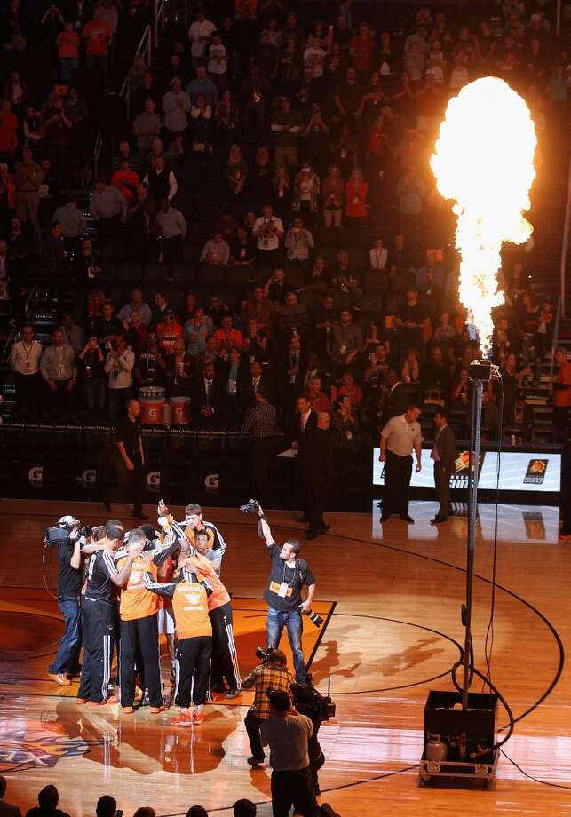 The Phoenix Suns huddle up during introductions to the NBA game against the San Antonio Spurs at US Airways Center on December 18, 2013 in Phoenix, Arizona. The Spurs defeated the 108-101.  NOTE TO USER: User expressly acknowledges and agrees that, by downloading and or using this photograph, User is consenting to the terms and conditions of the Getty Images License Agreement.  (Photo by Christian Petersen/Getty Images) Photo: Christian Petersen, Getty Images