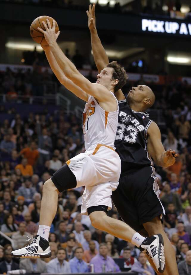 Phoenix Suns' Goran Dragic, of Slovenia, drives past San Antonio Spurs' Boris Diaw, of France, during the second half of an NBA basketball game, Wednesday, Dec. 18, 2013, in Phoenix. The Spurs won 108-101.  (AP Photo/Matt York) Photo: Matt York, Associated Press