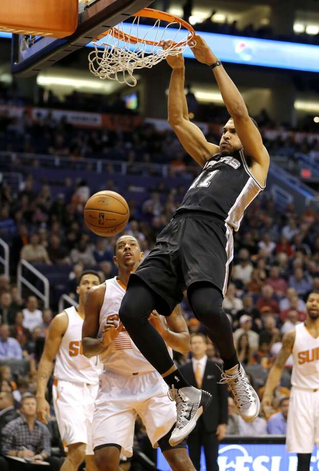 San Antonio Spurs' Jeff Ayres (11) dunks against the Phoenix Suns during the first half of an NBA basketball game, Wednesday, Dec. 18, 2013, in Phoenix. (AP Photo/Matt York) Photo: Matt York, Associated Press