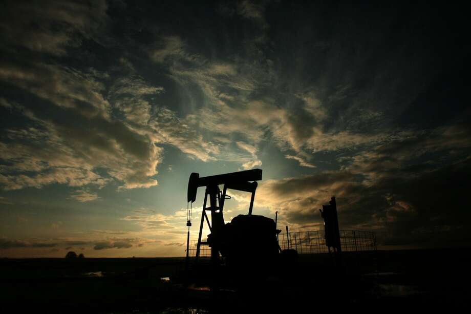 No. 1 -- The U.S. oil boom  The nation's oil output is expected to leap by a record-setting 1 million barrels per day by the end of the year, challenging Saudi Arabia as the world's top crude oil producer. Texas has led the way, with a surge in drilling activity in the South Texas Eagle Ford Shale and the West Texas Permian Basin. The oil boom has reignited talk of national energy independence and debate about lifting the ban on oil exports.  [Photo: An oil pump jack sits on the Osage County ranch in Oklahoma.] Photo: Mayra Beltran, Houston Chronicle