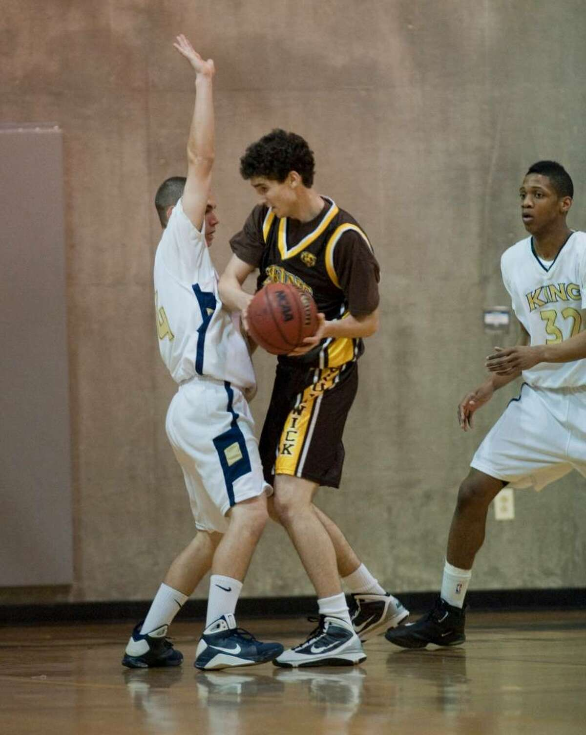 Matt Reggina and Jabrille Williams guard for King as Brunswick's Z Lynch with the ball during boys basketball Monday Feb. 1, 2010.