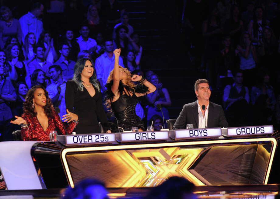 THE X FACTOR: L-R:  Kelly Rowland, Demi Lovato, Paulina Rubio and Simon Cowell on THE X FACTOR airing Wednesday, Dec. 18 (8:00-10:00 PM ET/PT) on FOX.  CR: Ray Mickshaw / FOX.