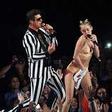 """Aug. 25: """"We Can't Stop"""" looking, no matter how much we try. Former TV tween queen Miley Cyrus appropriates (and revives) raver style for the MTV Video Music Awards and awkwardly twerks and grinds her way through giant teddy bears and Robin Thicke toward sex-pot-style relevance. OF the awards show, she later opines, """"I doubt they're ever gonna ask me back."""""""