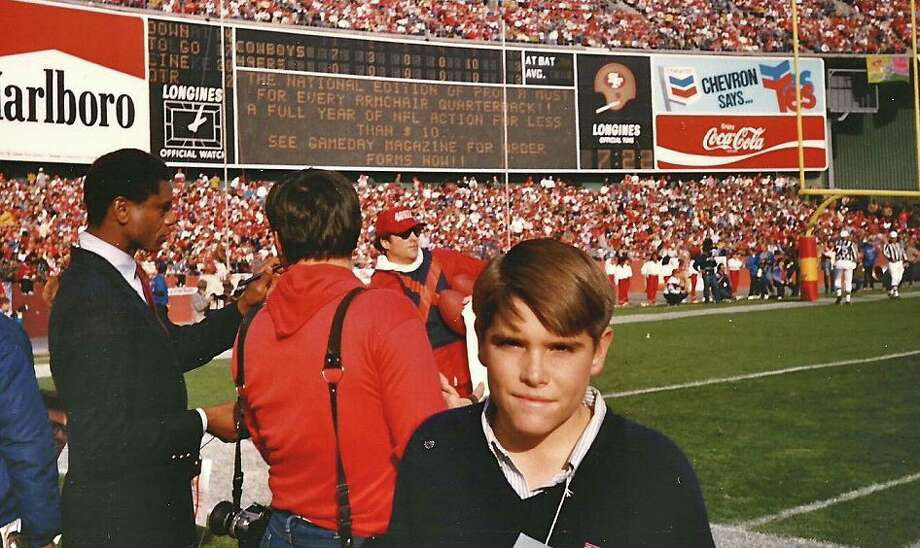 Dec. 22, 1985: Most of our photos in the Chronicle archives are in black and white. I was excited to see the Marlboro billboard and old 49ers scoreboard in color. 10-year-old Adam is trying to play it cool here ... Photo: Skeeter Hagler, (Courtesy Adam Flowers)