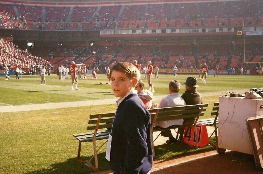 Adam on the sideline. I see Mike Wilson playing catch with a young Jerry Rice in the background, with the Berkeley Farms Jr. 49ers Club sign in back of that. Kind of surprised we don't see a frisbee dog. Photo: Skeeter Hagler, Courtesy Adam Flowers