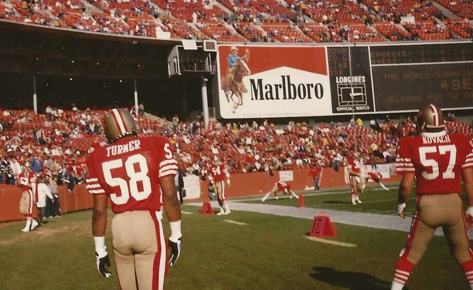 Keena Turner and a good angle of the Marlboro Man. Our family sits in Section 32, which overlooks this area near the end zone. Even back then, it was the part of the stadium that had the most fights. Photo: Skeeter Hagler, (Courtesy Adam Flowers)