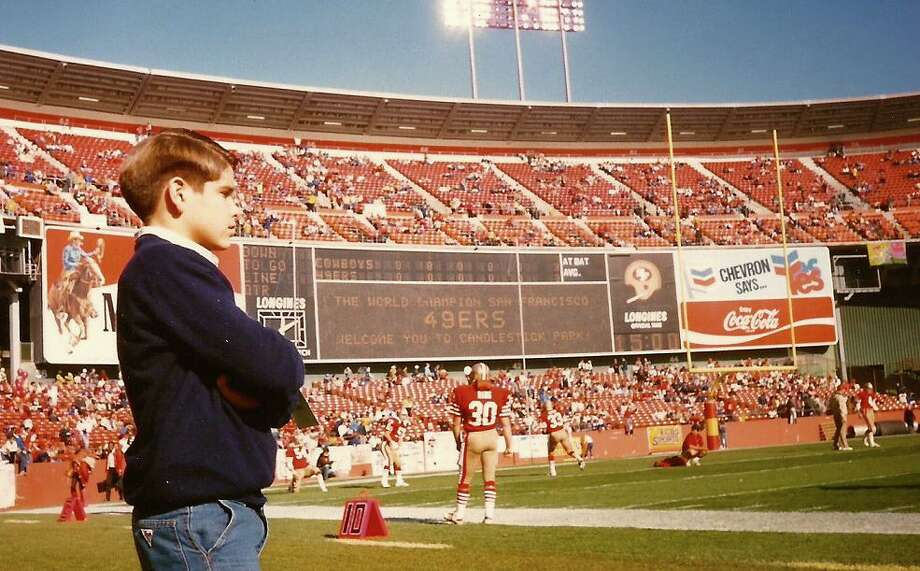 What's most shocking is how little the stadium has changed in 28 years. This scoreboard is identical, minus the Chevron and Coke ads, replaced with a Jumbotron. Quick, look to the left, Adam! there's Bill Ring! Photo: Skeeter Hagler, (Courtesy Adam Flowers)