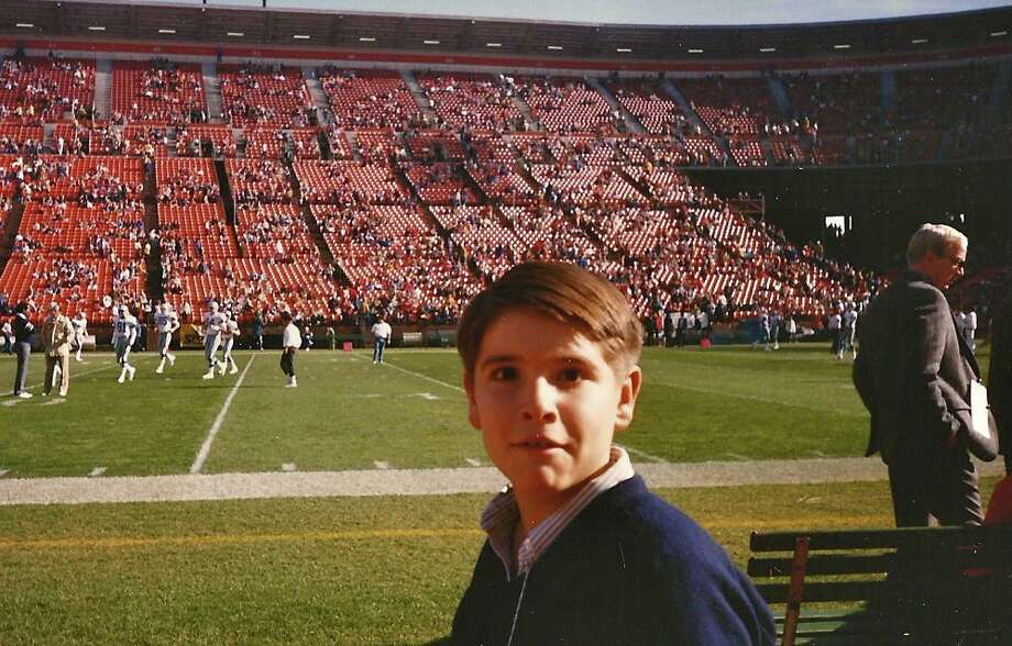 Adam, looking appropriately blown away by his luck. The photo messenger gods were good to Adam and his dad. This is a pretty nice and sunny day for three days before Christmas at Candlestick Park. Photo: Skeeter Hagler, Courtesy Adam Flowers