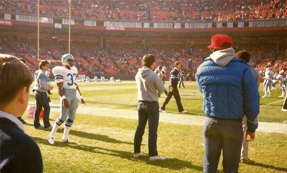 Adam stares at Tony Dorsett. Photo: Skeeter Hagler, Courtesy Adam Flowers