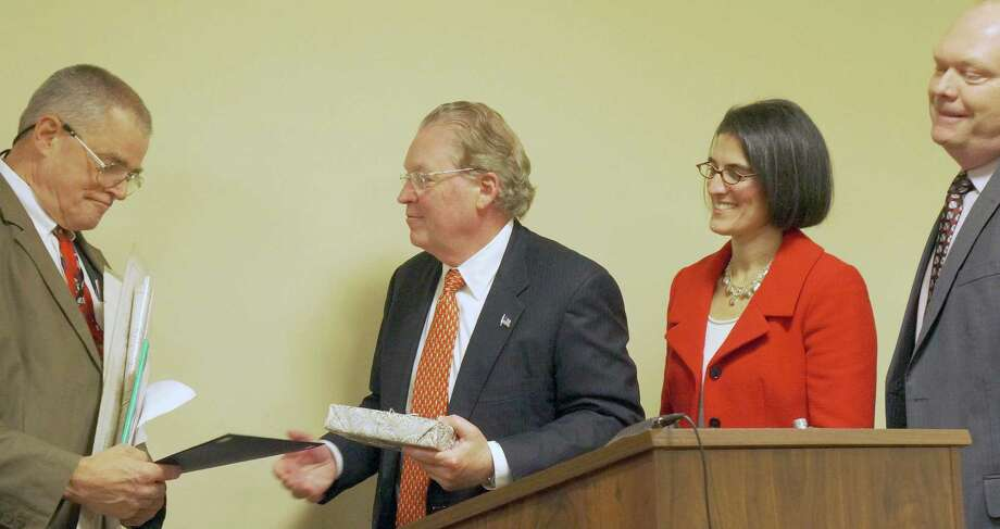 """Conservation Director Thomas Steinke, left, is presented the annual """"Employee of the Year"""" award by members of the Selectmen, from left, First Selectman Michael Tetreau and Selectmen Cristin McCarthy Vahey and Kevin Kiley. Photo: Genevieve Reilly / Fairfield Citizen"""
