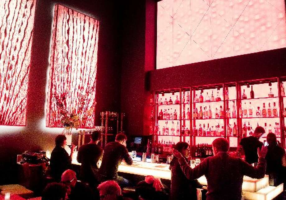 The bar at Amber India features lights constantly change the colored atmosphere.