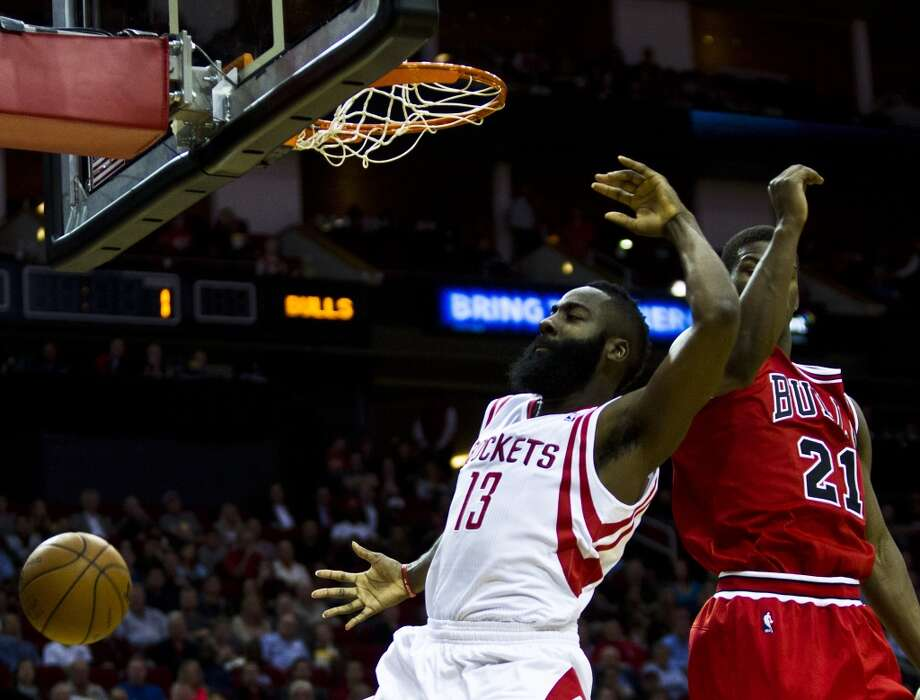 Dec. 18: Rockets 109, Bulls 94  Rockets shooting guard James Harden (13) dunks under the pressure of Bulls shooting guard Jimmy Butler (21). Photo: Marie D. De Jesus, Houston Chronicle