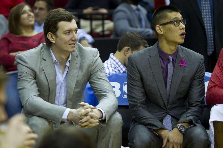 Rockets center Omer Asik (3) sits by Rockets point guard Jeremy Lin (7) on the bench. Photo: Marie D. De Jesus, Houston Chronicle