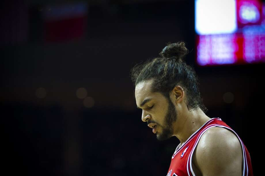 Bulls center Joakim Noah (13) can't help but to show his disappointment after Rockets power forward Terrence Jones (6) scores. Photo: Marie D. De Jesus, Houston Chronicle
