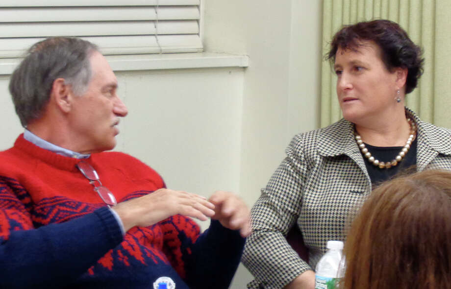 John Pincavage, the Board of Finance chairman, and Elaine Whitney, the Board of Education chairwoman, discuss a projected $2 million school budget deficit at a special workshop session called Wednesday to address the problem. Photo: Meg Barone / Westport News contributed