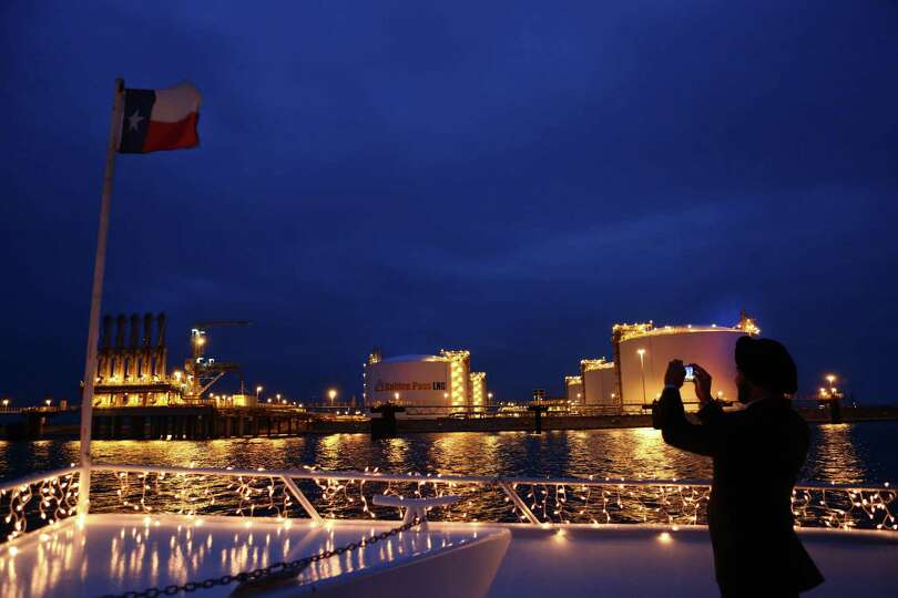 Sabine Pass Dinner Cruise attendee snaps photos of the Golden Pass LNG storage tanks and cargo trans