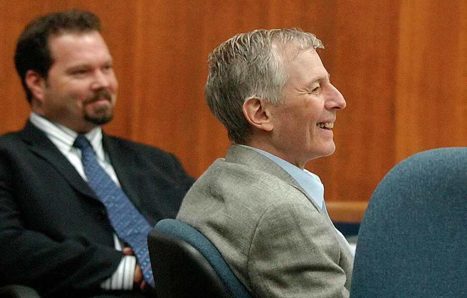 Defendant Robert Durst, right, and one of his defense attorneys, Chip Lewis, laugh at a comment during testimony in his murder trial in Galveston, Texas, Tuesday, Sept. 23,  2003.  (AP Photo/LM Otero)  HOUCHRON CAPTION  (09/24/2003):  Robert Durst admits posing as a mute woman to rent the apartment across the hall from Morris Black's in November 2000. Photo: LM OTERO, AP / AP