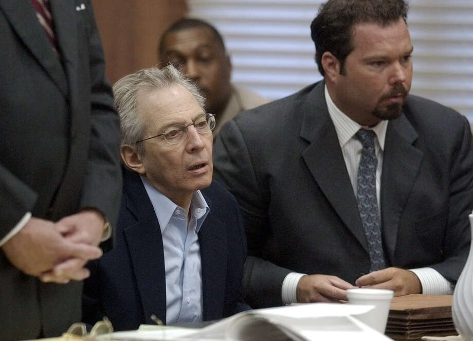 New York multi-millionaire Robert Durst, left, and his attorney Chip Lewis react to the $2 billion bond set on Durst's bond jumping charges by Judge Susan Criss Wednesday, Dec. 3, 2003, in Galveston, Texas. Durst was acquitted last month of murder charges but remains jailed on the bond jumping. (AP Photo/Pat Sullivan). HOUCHRON CAPTION (01/31/2004 - 2-STAR):  Robert Durst received a tip on a Realtor from the juror who visited him. Durst is considering buying property in League City.   HOUCHRON CAPTION (01/31/2004):  Durst :  Received a tip about a Realtor from juror who visited him. Photo: PAT SULLIVAN, AP / AP